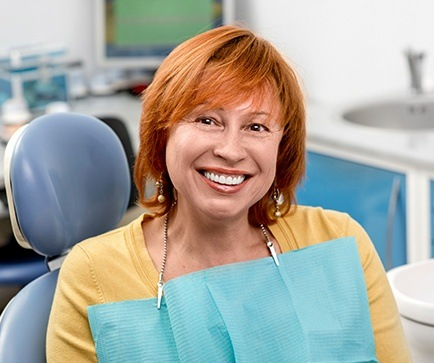 Smiling older woman in dental chair