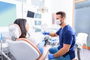 woman talking to dentist in Marion