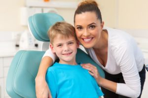 mother and son visit dentist in Marion